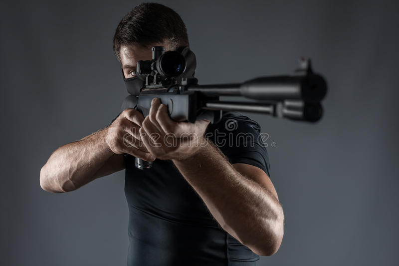 Close-ups of man with sniper rifle aiming isolated stock photography