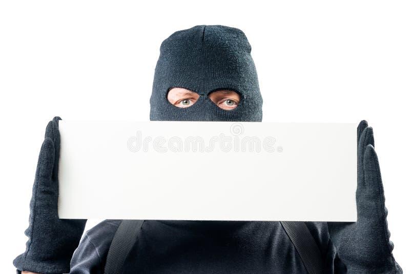 Close-upspatie voor inschrijvingen en een portret van een misdadiger binnen royalty-vrije stock afbeeldingen