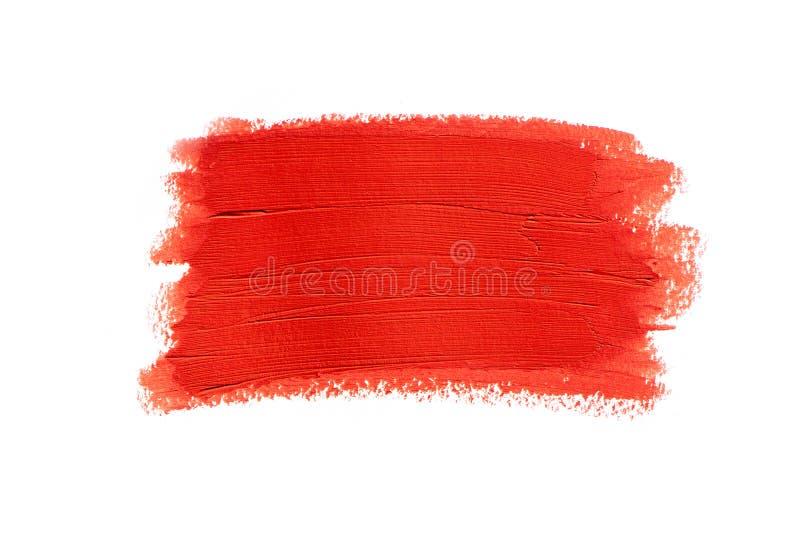 Close-upvlek van rode lippenstift die op witte achtergrond wordt geïsoleerd stock fotografie