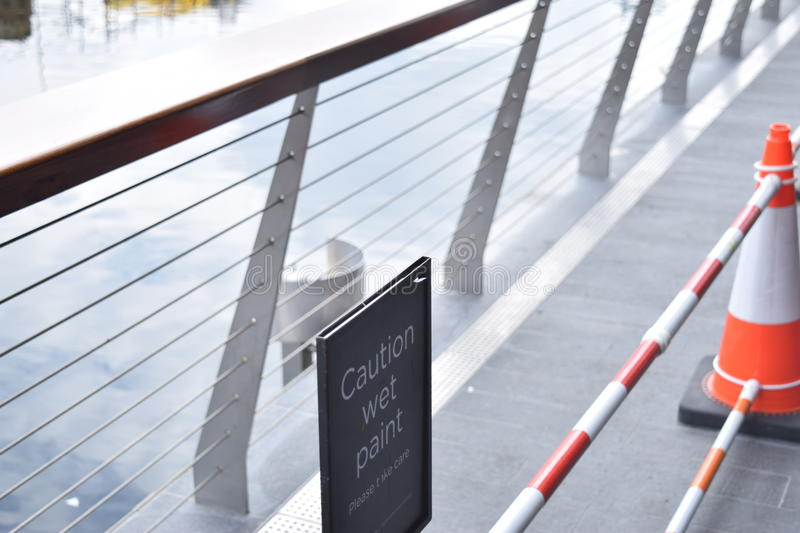 Close view of a bridge railing with orange and white cones royalty free stock images