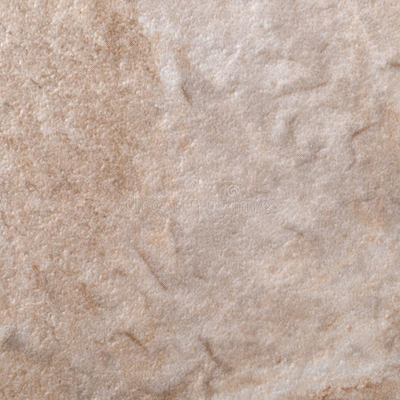 Close view of brown and tan vinyl floor tile. Very close view of brown and tan vinyl floor tile stock images