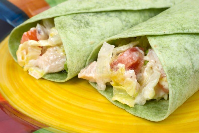 Close view chicken salad spinach wraps stock photos