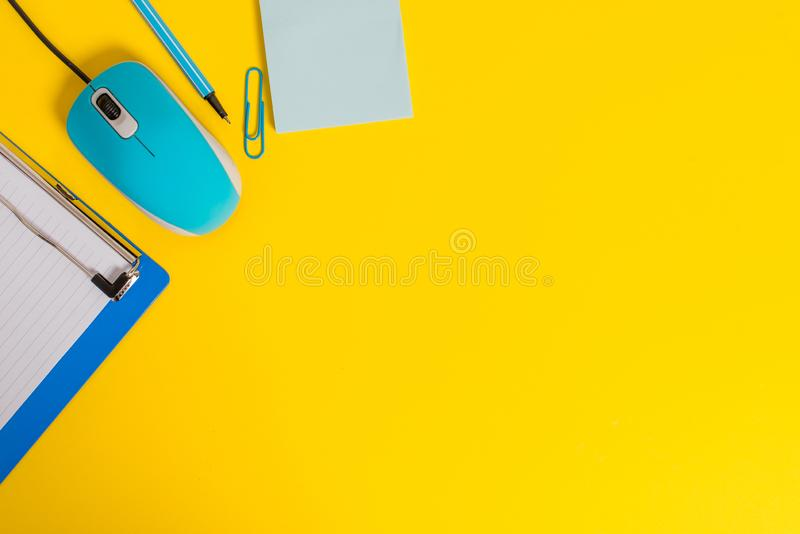 Close view clipboard blank striped paper sheet clip binder pencil marker sticky note computer wire mouse gadget colored stock image