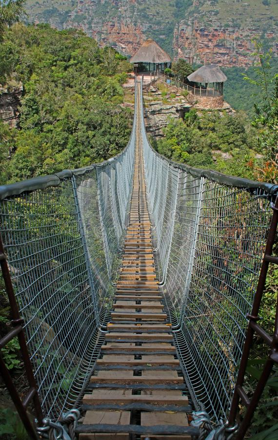 CLOSE VIEW OF ENTRANCE OF SUSPENSION BRIDGE OVER ORIBI GORGE stock image