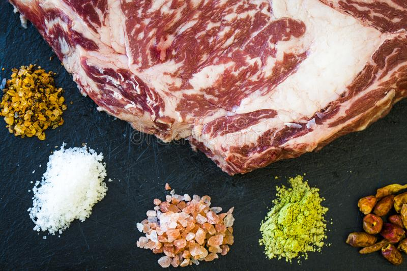 A close view of fresh steak with spices royalty free stock image