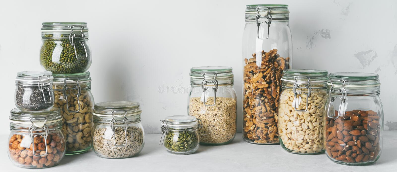 Glass jars with Superfoods nuts and cereals stacked on top of each other stock photography