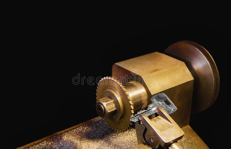 Close view of key copying machine with key in locksmith workshop stock photos