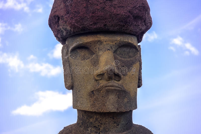 Close view of Moai Statue Face of Ahu Nau Nau wearing topknot near Anakena Beach - Easter Island, Chile. Close view of Moai Statue Face of Ahu Nau Nau wearing royalty free stock image