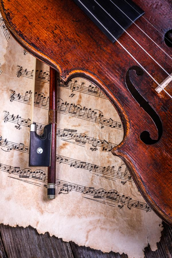 Close view of an old, used violin and bow royalty free stock photo