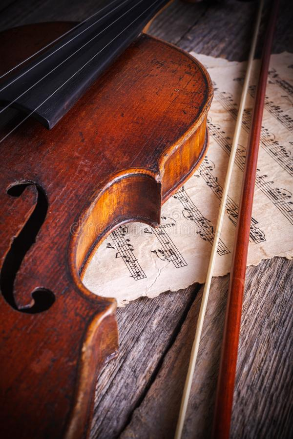 Close view of an old, used violin and bow stock photo