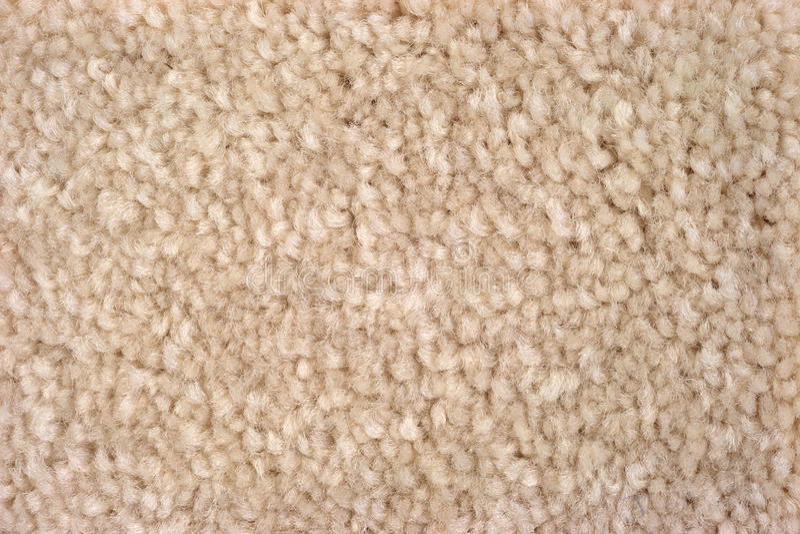 Close view of plush tan carpeting stock photo