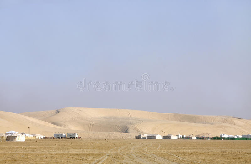Close view of sand dunes & camping huts royalty free stock photos