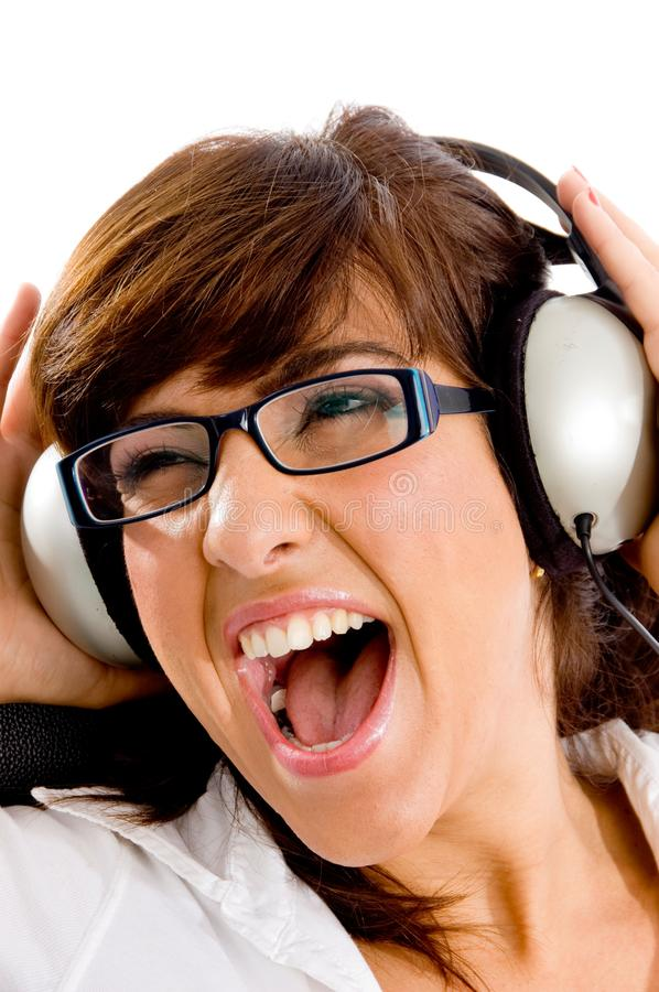 Download Close View Of Shouting Woman Listening Music Stock Photo - Image of music, pose: 8386426