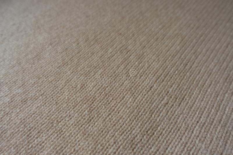 Close view of beige knitted fabric royalty free stock photos