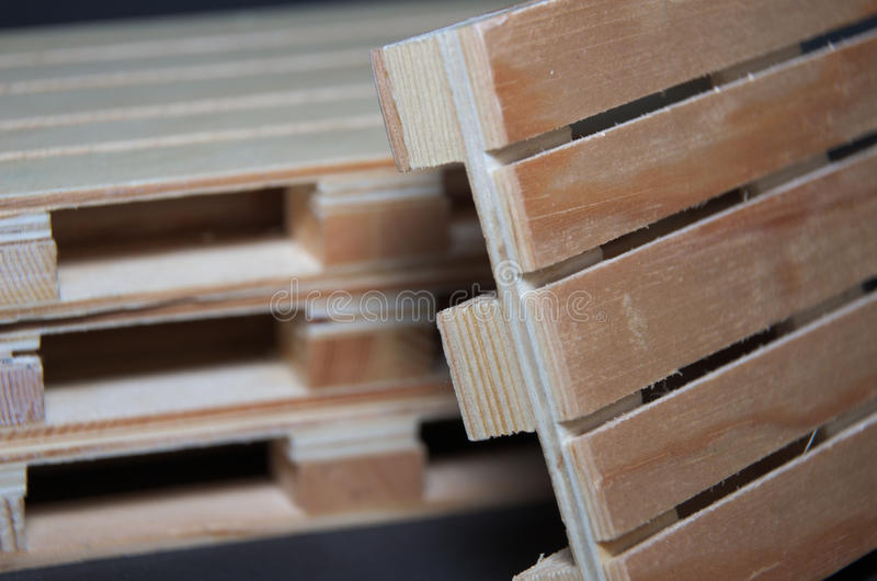 Close view of stack wooden pallets. Flat transport structure. For support of goods royalty free stock photos