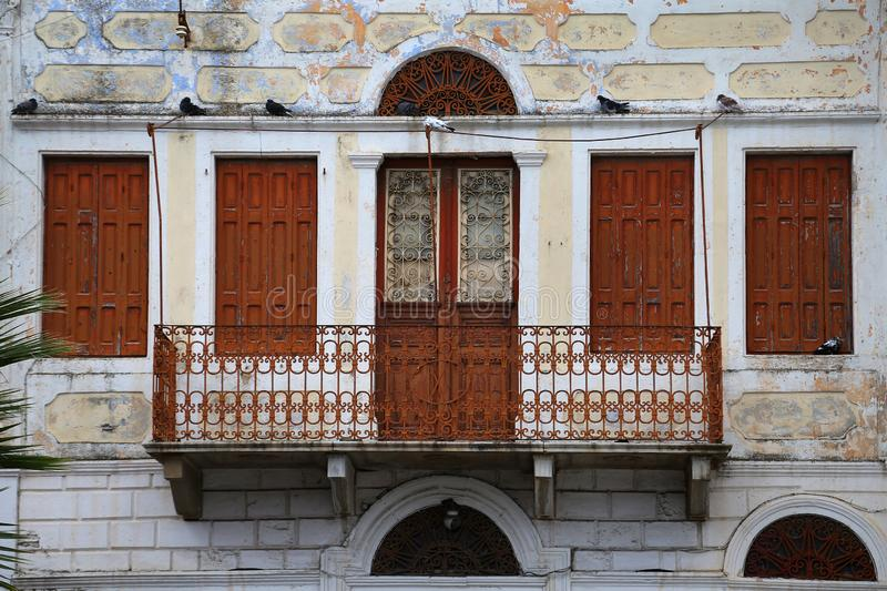 A close view of a stone, old, traditional house and it`s balcony in Calymnos Island royalty free stock images