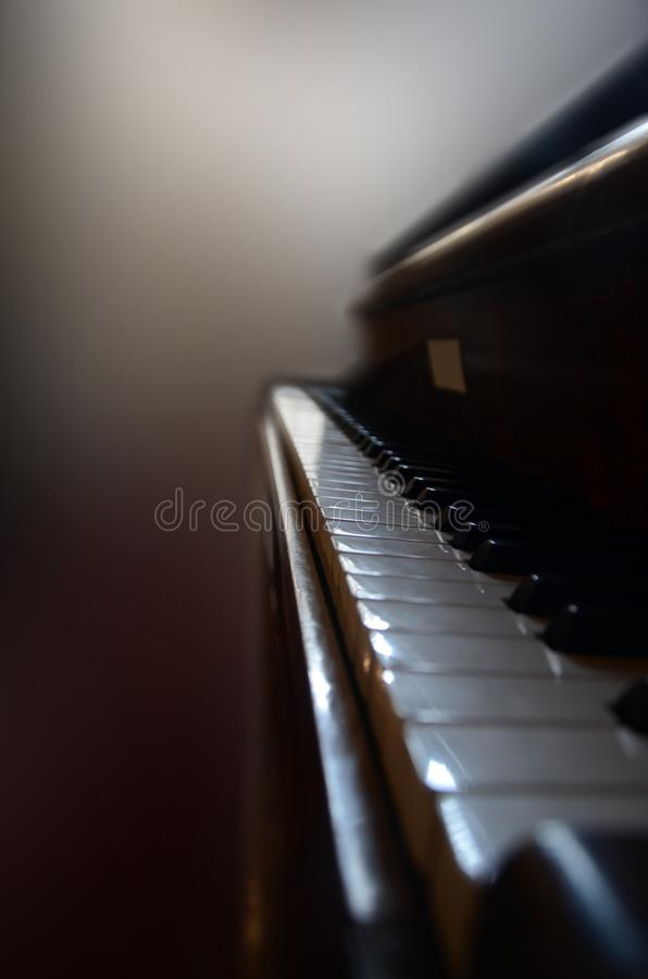 Close view to a vintage piano stock image