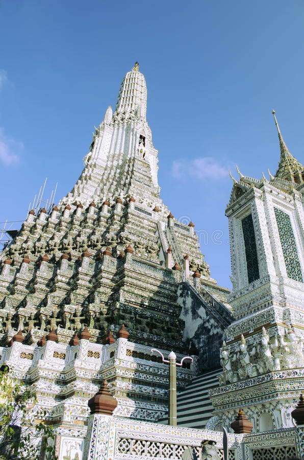Close view of Wat Arun buddhist temple in Bankok, Thailand. Close view of Wat Arun buddhist temple against clear blue sky in Bankok, Thailand royalty free stock photos