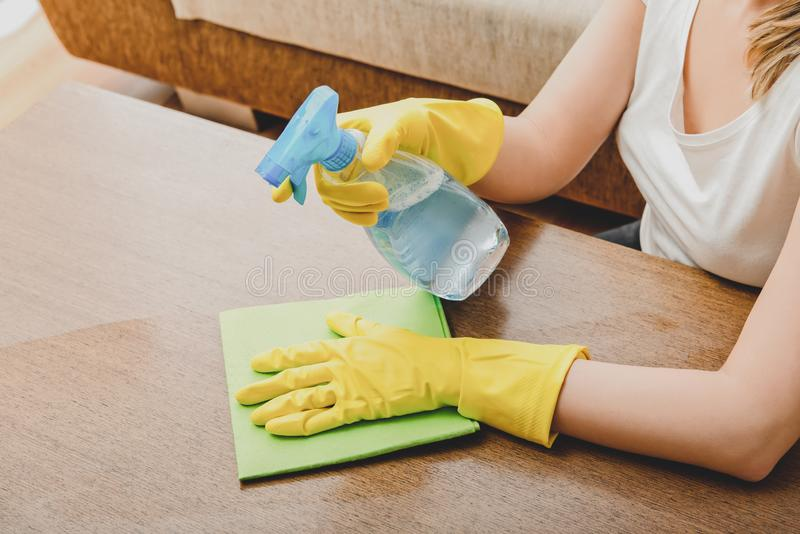 Cleaning home with spray stock images