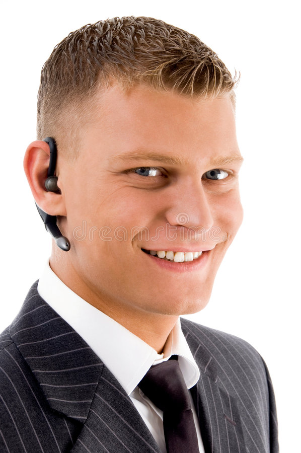 Close view of young executive with blue tooth stock photo