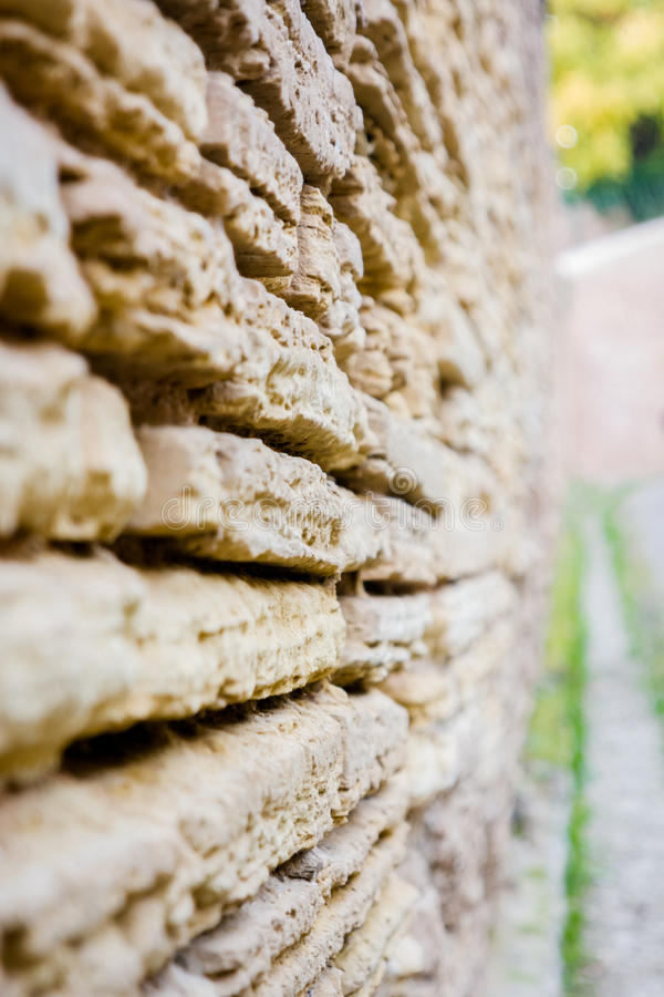 Close wall II. Detail of an ancient eroded stone wall royalty free stock images