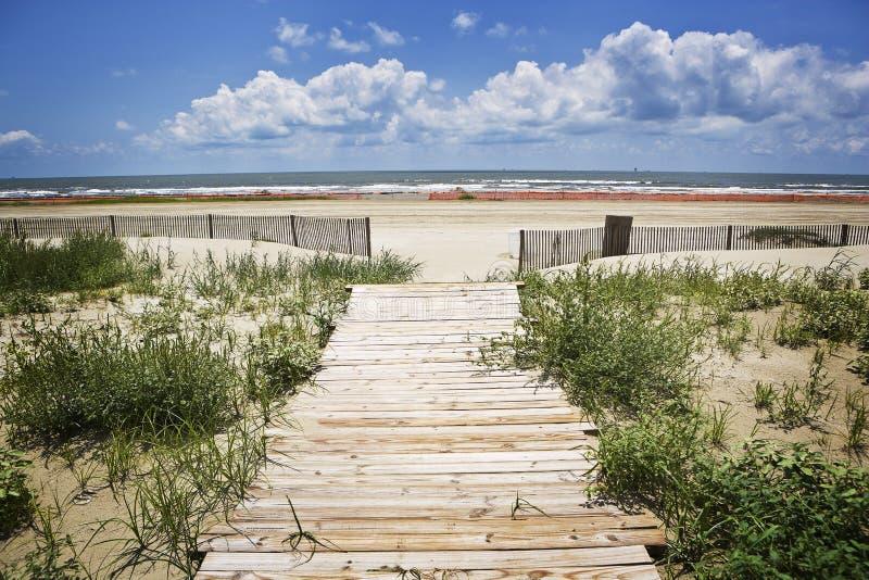 Closed Beach & Boardwalk, Gulf Coast. An empty and closed beach and wooden boardwalk along the Gulf Coast in July royalty free stock image