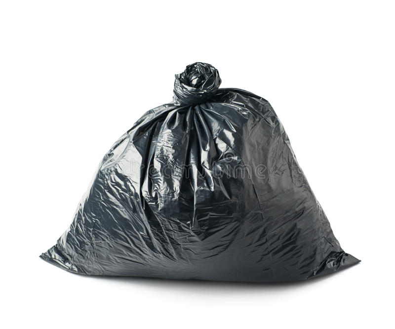 Closed black garbage bag isolated. Closed and tied in a knot black plastic garbage bag isolated over the white background royalty free stock photo