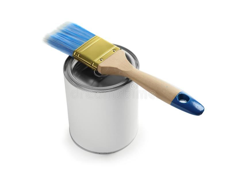 Closed blank can of paint with brush isolated. On white royalty free stock photography