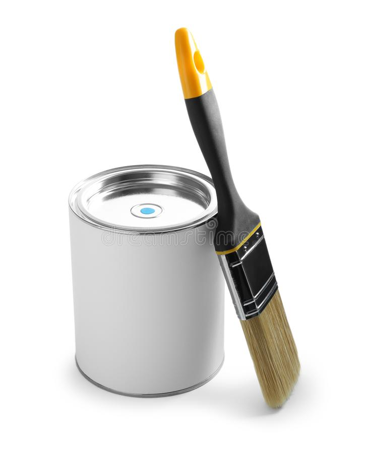 Closed blank can of paint with brush on white. Closed blank can of paint with brush isolated on white royalty free stock images