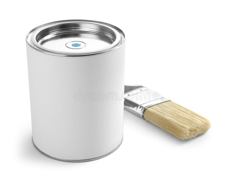 Closed blank can of paint with brush on white. Closed blank can of paint with brush isolated on white royalty free stock photo