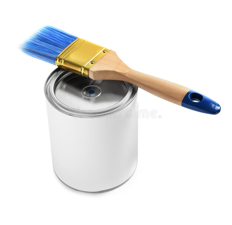Closed blank can of paint with brush on white. Closed blank can of paint with brush isolated on white royalty free stock photography