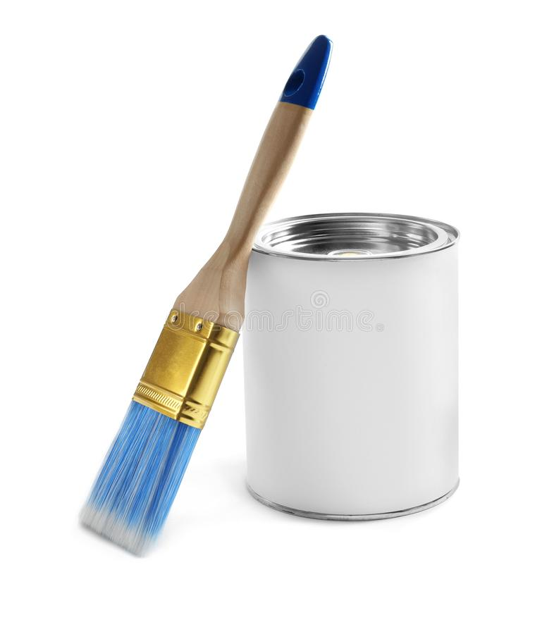 Closed blank can of paint with brush isolated. On white stock images