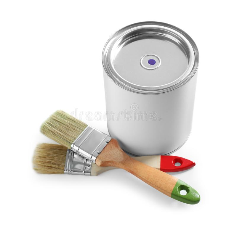 Closed blank can of paint with brushes isolated. On white stock images