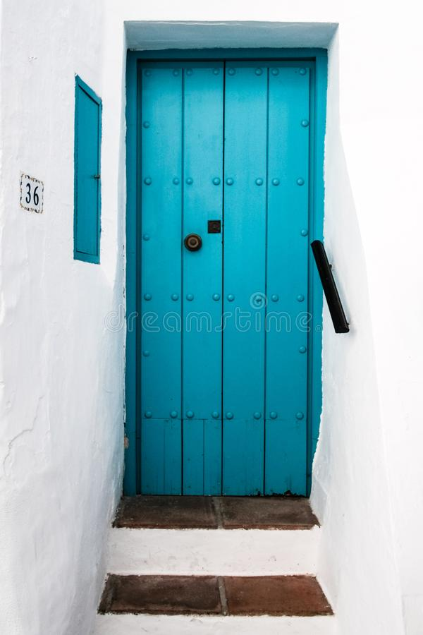 Closed Blue Wooden Door royalty free stock image