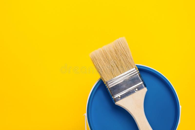 Closed bucket with classic blue paint and brush. Repair and renovation home concept royalty free stock photos