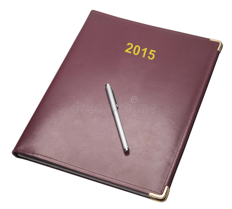 Closed burgundy note pad, isolated stock photos