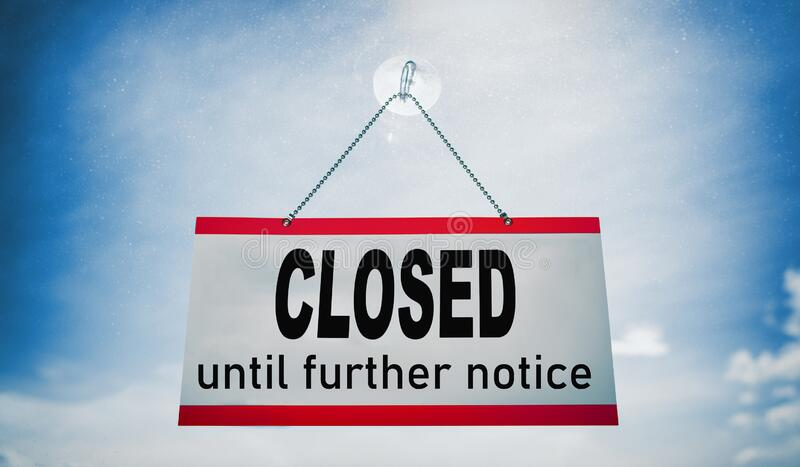 Closed businesses until further notice for COVID-19 , closure sign hanging on storefront window. Government shutdown of stock photography