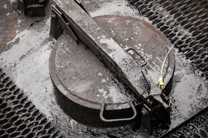 Closed cap on railroad oil tank stock photos