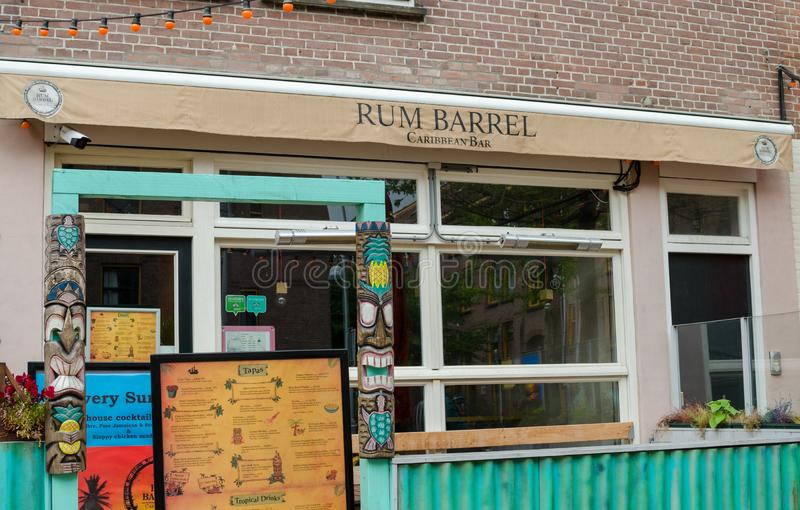 Closed Caribbean Bar `Rum Barrel` in Javastraat street, Oost, Amsterdam, Netherlands. Outside street view. Closed Caribbean Bar `Rum Barrel` in Javastraat stock image