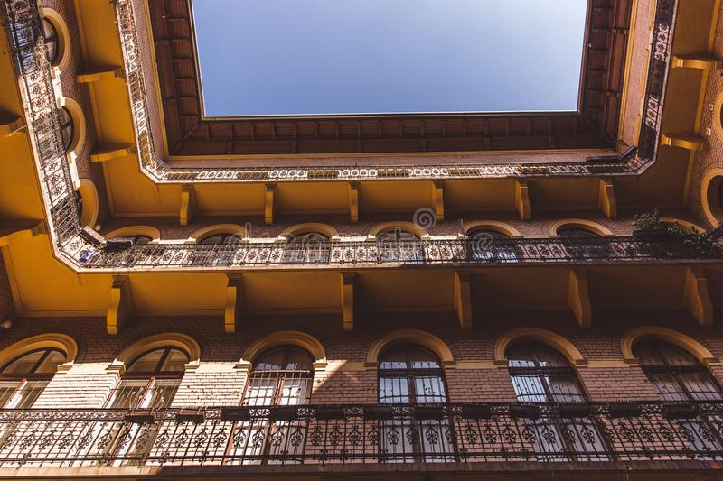 Closed courtyard-well of the old historical Building in Budapest city. Bottom view upwards royalty free stock photography