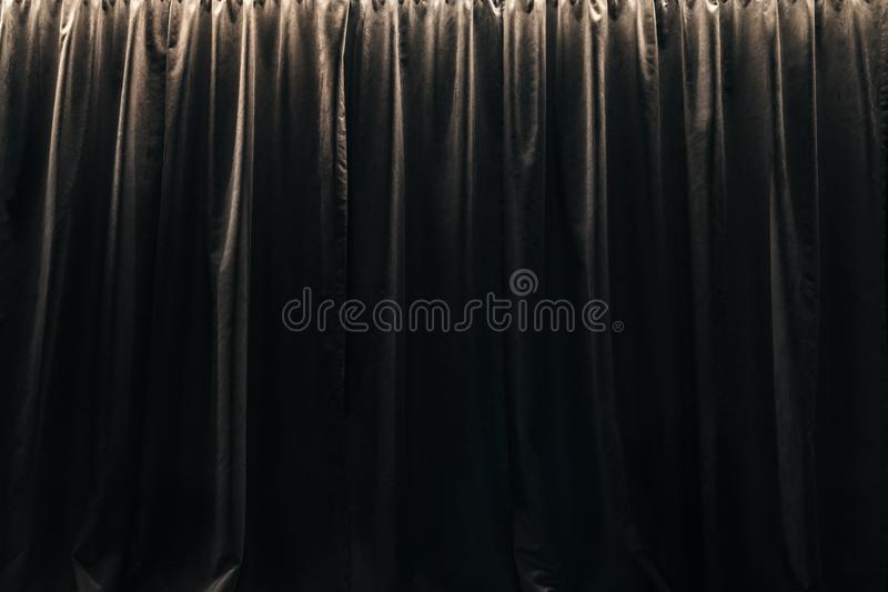 Closed curtain of black velvet curtains royalty free stock photo