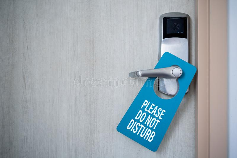 Closed door of hotel room with please do not disturb sign. Hotel Door Hanger Tags Mockup royalty free stock photos