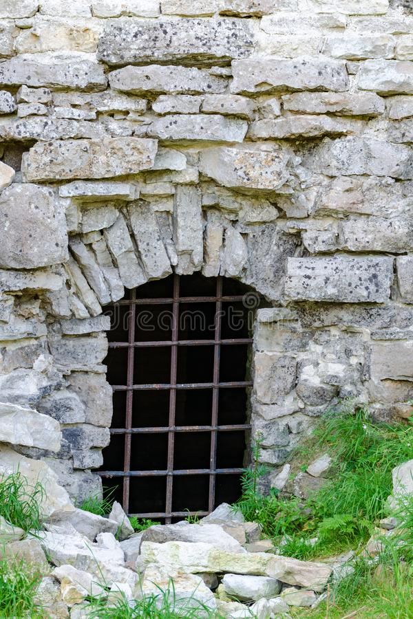 Closed entrance to ruins of medieval castle. stock photos
