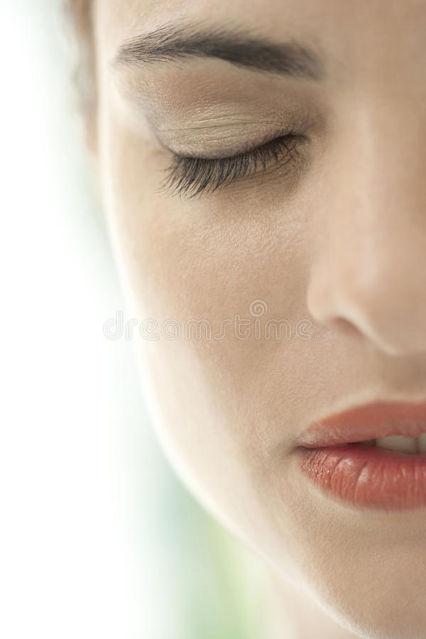 Closed Eyes Beauty Close Up. Close up view of a woman's haf face with eyes shut royalty free stock photography