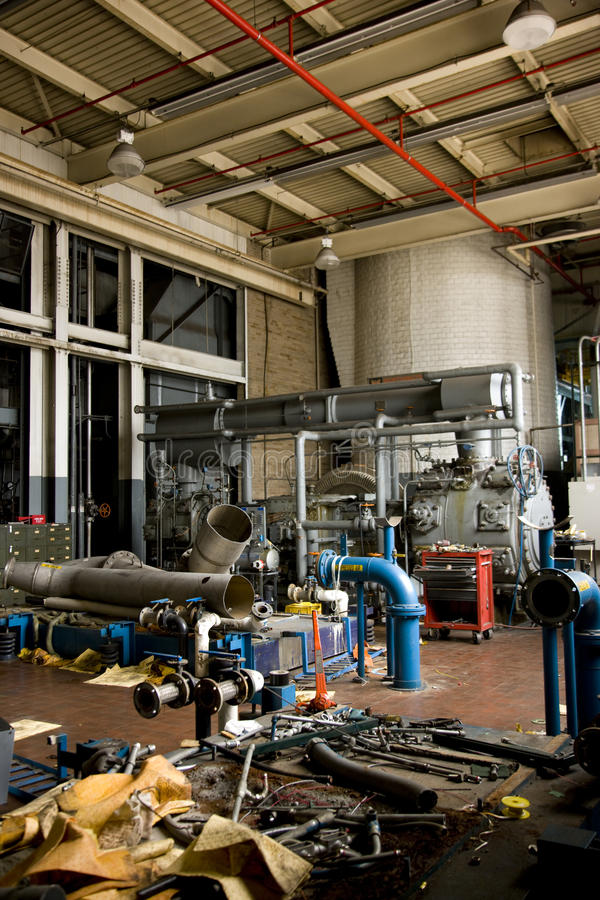 Closed factory. Disassembled machine floor in closed factory stock photography