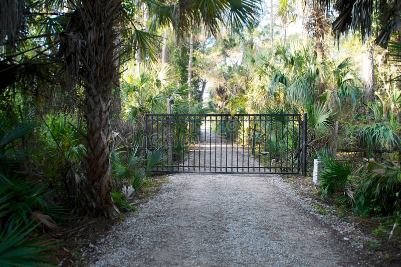 Download Closed gate on dirt road stock photo. Image of tropical - 38251014