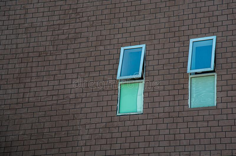 Closed glass windows brick brown wall royalty free stock images