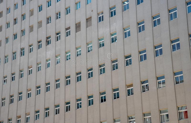 Closed glass windows  skyscraper office building stock photography