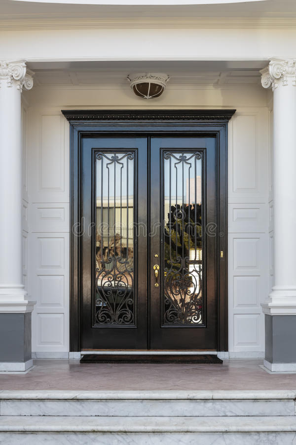 Closed Glossy Black And Glass Front Doors Of An Upscale