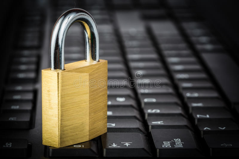 Download Closed Golden Padlock On A Black Keyboard Stock Image - Image: 35095465